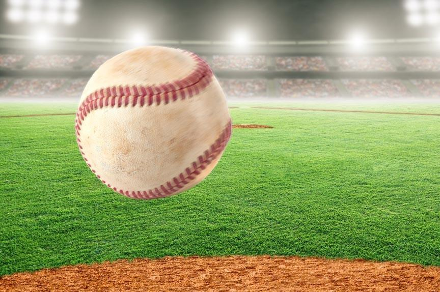 BASEBALL FROZEN IN AIR WITH BASEBALL DIAMOND BACKDROP